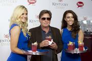 Emilio Estevez, was served Grey Goose vodka cocktails by hostesses on the red carpet at Churchill Downs.