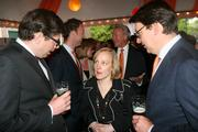 Maarten van Rossum, first secretary of the Royal Netherlands Embassy, left;  Michelle DeMoor, senior director of international policy and government relations for Philips Electronics North America; and Job van den Berg, deputy head of the economic department at the Royal Netherlands Embassy; attend a reception at the embassy in Washington on April 30.