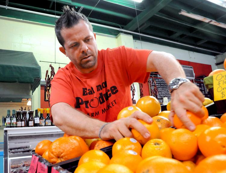Troy Gage, owner of Eat More Produce, had issues with his greencard application when he moved to Orlando from Ontario.