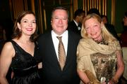 From left, Marie Royce of Alcatel-Lucent; Gilles Noghes, Monaco's ambassador to the U.S.; and Ellen Noghes attend a dinner at the Andrew Mellon Auditorium in D.C. on May 2. The event raised money for Refugees International.