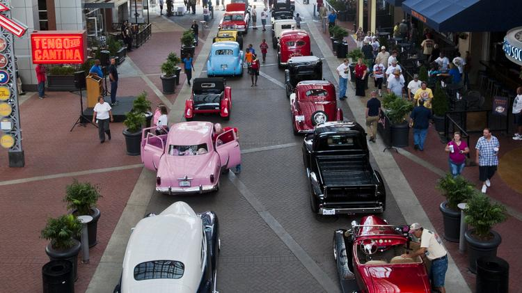 Nearly 30 vintage cars in town for the Street Rod Nationals paraded Wednesday at Fourth Street Live.