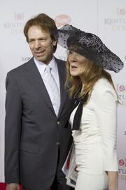 Film and television producer Jerry Bruckheimer and his wife, Linda Bruckheimer, posed for photos on the red carpet.