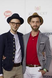 "Designer Gunnar Deatherage from season 10 of Lifetime's ""Project Runway,"" right, stopped for a photograph on the red carpet."