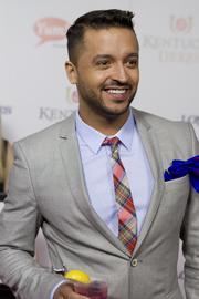 "Television personality and former host of television show ""Queer Eye""Jai Rodriguez holds a Grey Goose cocktail while standing for photographs on the red carpet."