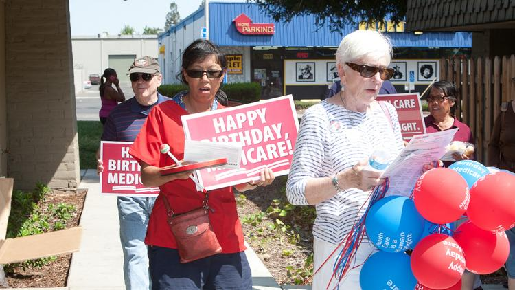 Nurses and other supporters of a single-payer health care system took to the streets in 15 cities in support of Medicare for all, including in front of the Social Security Office on Arden Way.