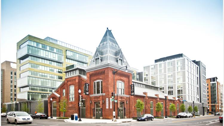 City Market at O: Architects purposefully blended the historic, red-brick market, now a Giant, with modern, glass-encased apartment buildings, one a bold green and one a drab gray.