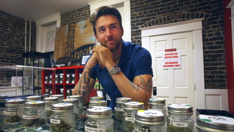 Cannabliss owner Matt Price at the counter of his medical marijuana dispensary at 1917 S.E. 7th Ave. Landlords are balking, at least a little, so far at renting to cannabis industry tenants.