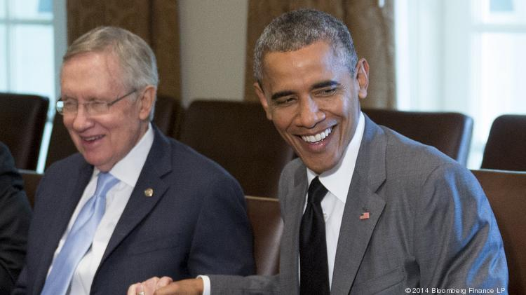 President Barack Obama, shown here with Senate Majority Leader Harry Reid during a White House meeting Thursday, signed an executive order that he says will keep companies that aren't playing by the rules from receiving federal contracts.