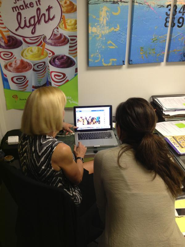 Two members of Jamba Hawaii's marketing team work on the company's Facebook page. Jamba Hawaii is joining PBN's Social Madness social media challenge to boost the company's online engagement.