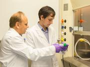 At left, Niranjan Pandey, senior director of research and development, and Eric Bressler, research specialist, work in the lab at AsclepiX Therapeutics.