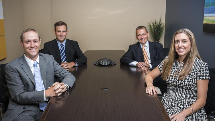 Mariner Holdings' acquisition of Allied Business Group affects David Holzman (from left), Tim Skarda, Marty Bicknell and Cheryl Vohland, Mariner's chief strategy officer.
