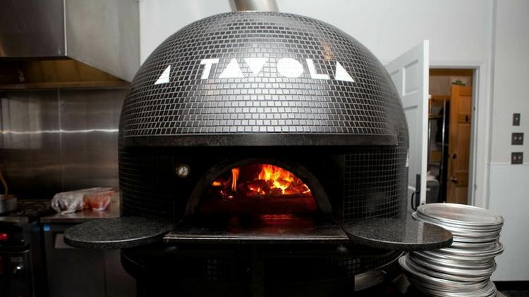 A Tavola Bar and Trattoria has hired 20 more employees so it will have enough pizza makers and wait staff to start serving lunch today at its flagship store in Over-the-Rhine and new location in Madeira.