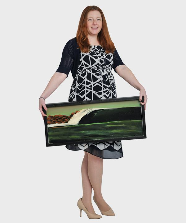 Drysdale holds a painting of a famous surf break from her hometown, Atlantic Beach, Florida. She says her first leadership role was with the Surfrider Foundation in Florida.