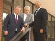 From the left: Sandy Wilkes of Wilkes Co., Robert Gladstone of Quadrangle and Pastor Joseph Evans of Mount Carmel Baptist. When this photo was taken in 2005, the three had formed a partnership to construct a mixed-use building at 801 Third St. NW. Only it took nine years to acquire the lots.