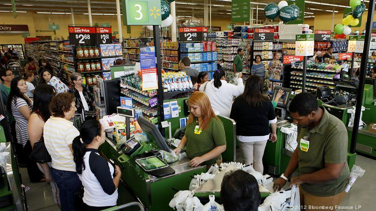Customers check out during the grand opening of a Wal-Mart Stores Inc. location in Panorama City, California, in September 2012.