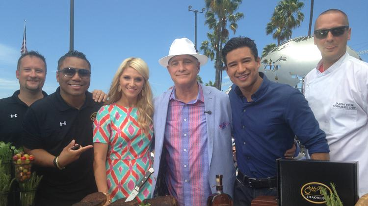 "Jeff Ruby and his restaurant team are going to get a blast of exposure when they are featured on an episode of ""Extra"" all across the nation tonight. From left are Jason Kersey, Bawe Shinholster, Britney Ruby Miller, Jeff Ruby, Mario Lopez and Chef Jason Rose."