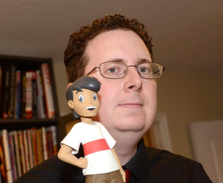 Benny Powell with a maquette of the character Niko from Red Giant's animated film Journey to Magika