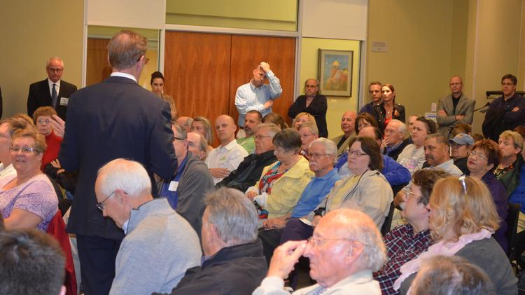 Owen Buckley, president of Lane4 Property Group Inc., answers a question during a neighborhood meeting about the future of the Metcalf South and 95 West shopping centers. The developer met with neighbors in April.