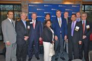 From left, Arvind Manocha of the Wolf Trap Foundation, Bradley Schwartz of Blue Canopy, Jim Corcoran of the Fairfax Chamber, Tien Wong of Opus8, Dolly Oberoi of C2 Technologies, U.S.Sen. Mark Warner, Mark Moore of John Marshall Bank, Sid Chowdhary of Credence Management Solutions, Rob Franklin of MorganFranklin and Ed Barrientos of Brazen Careerist.