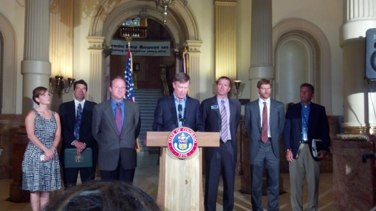 Colorado Gov. Hickenlooper announces plans for a blue-ribbon task force to study the issue of local control of oil and gas drilling Monday at the Capitol. On his right is U.S. Rep. Jared Polis, D-Boulder.