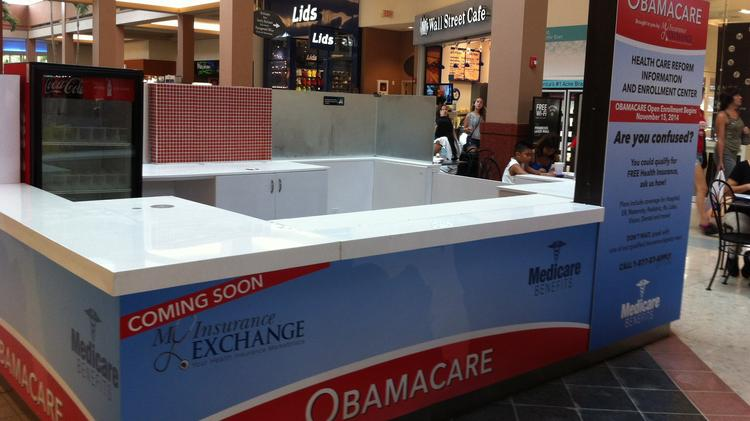 In early August, a booth was set up in the food court of the Pembroke Lakes Mall to prepare for the Affordable Care Act insurance exchange enrollment period that will start in November.