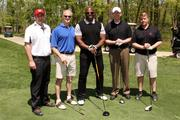 From left, Brian Meincke of Mythics, John Lind of Equinix, former Washington Redskins player Ken Harvey, and Conor Gleeson and Jeff Lush, both of Dell.