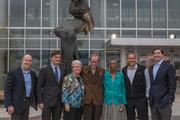 """From left, Jim Garibaldi and Jay Klug, both of BG Rosenfeld Retail; with Kate Hanley, former chair of the Fairfax County Board of Supervisors; Robert Cole, sculptor of """"The Thought,"""" Fairfax County Supervisor Cathy Hudgins; Grant Ehat of JBG Rosenfeld Retail; and Greg Trimmer of The JBG Cos."""
