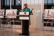 """About 80 people attended the unveiling of public art sculpture """"The Thought"""" at JBG Rosenfeld Retail's mixed-use Tysons West project April 15. Fairfax County Supervisor Cathy Hudgins spoke at the event."""