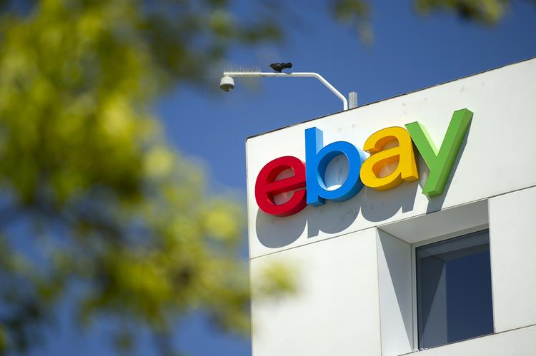 A bird sits over eBay Inc. signage displayed on the facade of the company's headquarters in San Jose, Calif. The online retailer has tweaked an agreement with Austin that would lower average annual wages for new hires but retain $1.25 million in economic incentives.