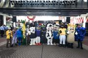 A group of Louisville companies' mascots lined up for a photo.