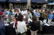 Crowds were greeted by a large variety of information booths at Fourth Street Live, touting various destinations in Louisville as part of Hometown Tourist Month.