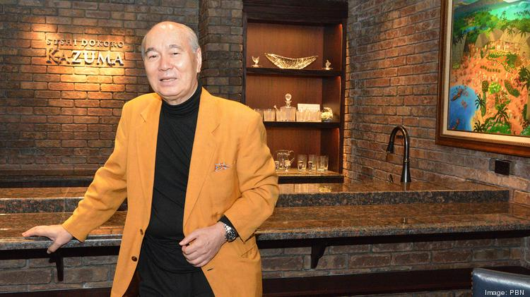 Takeshi Sekiguchi, seen inside his Vintage Cave Honolulu restaurant, says his new Hawaii real estate firm, SRE Matrix, can beat the online firm Zillow.
