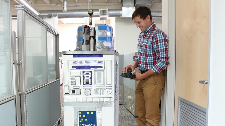 R2BeerMe with its inventor, Cresa advisor Charlie Wolff.
