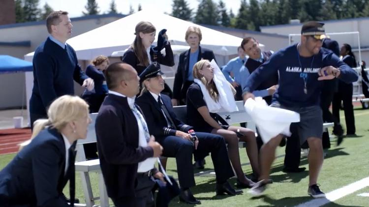 Seattle Seahawk quarterback Russell Wilson, right, stars in three new commercials for Alaska Airlines.