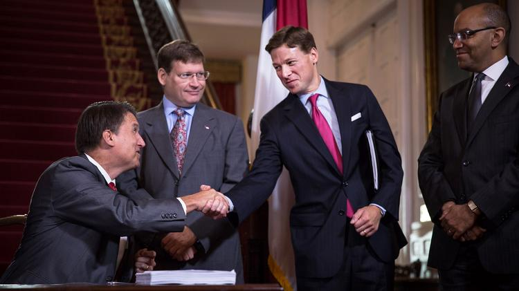 Gov. McCrory signed the 2014 North Carolina state budget at the Executive Mansion on Aug. 7, 2014, and welcomed Lee H. Roberts, N.C. State's new budget director, a former exec at VantageSouth.