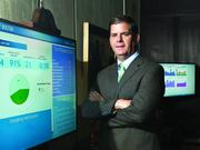 """Boston mayor Marty Walsh with one of two """"data dashboards"""" he uses to keep tabs on the city."""