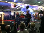 Arizona Gov. Jan Brewer stands between Solar Impulse pilots Bertrand Piccard, left, and André Borschberg after presenting her with a flag from the plane during their visit recently to Phoenix.