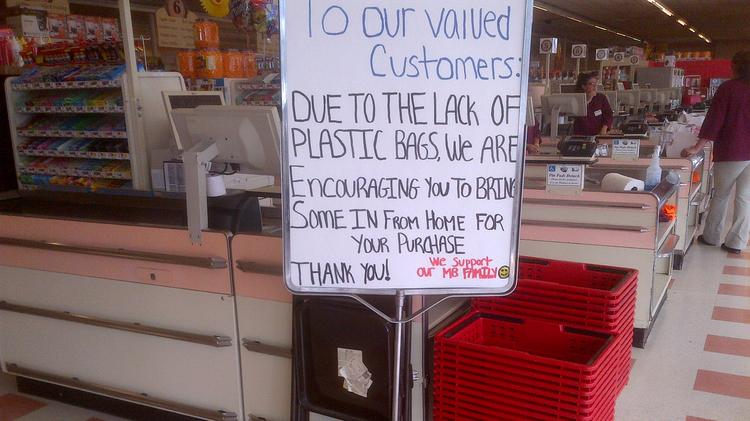 Market Basket employees warned workers of a plastic bag shortage at the store on Wood Street in Lowell. The store, like other Market Basket shops, was nearly devoid of fresh produce, meat and dairy products.
