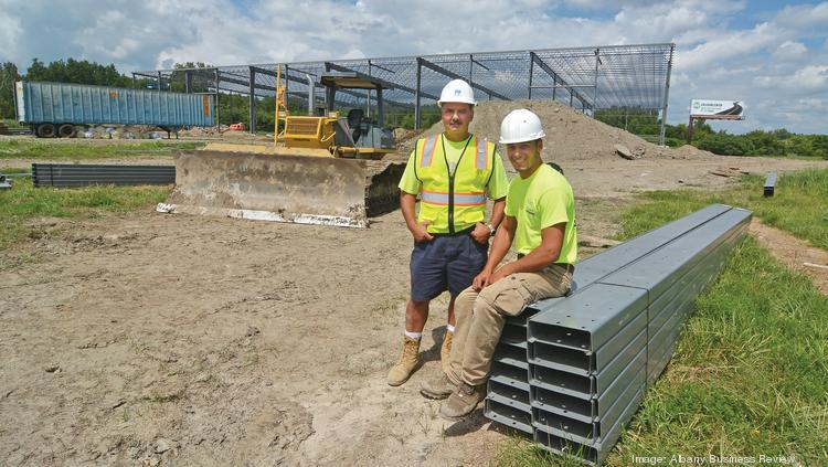Construction of the new Sky Zone center at 50 Simmons Lane in Menands, New York. From left Fusco Realty Group owner David Fusco and with his son, construction manager Michael Fusco.