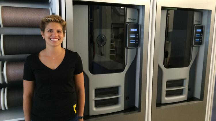 Normal CEO and founder Nikki Kaufman poses in front of two of the startup's 10 Stratasys 3D printers.