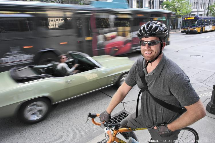 Ian Blaine, CEO of thePlatform, commutes by bike to his office along Seattle's Third Avenue. During his morning commute, Third Avenue is restricted to buses and bikes — and Blaine says that works out fine because the bus drivers are more aware of bikes on the road than the typical driver of a car.