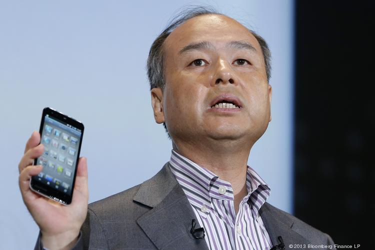 Masayoshi Son, president of SoftBank Corp., introduces the company's new smartphone during a product launch in Tokyo on Tuesday.