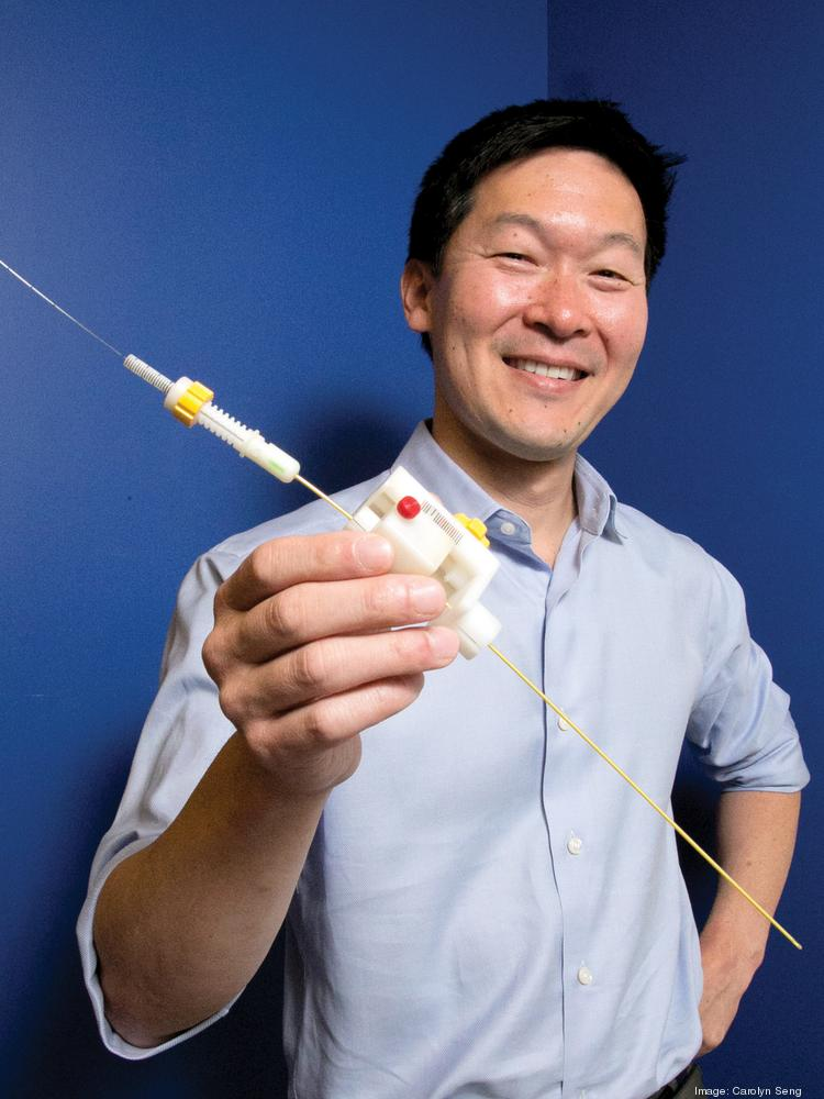 UCSF neurosurgeon Dr. Daniel Lim with the new device that he developed and Accurexa Inc. wants to commercialize.