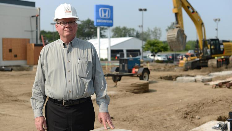 Tom Langer, president of Langer Construction, at a project at Buerkle Honda.