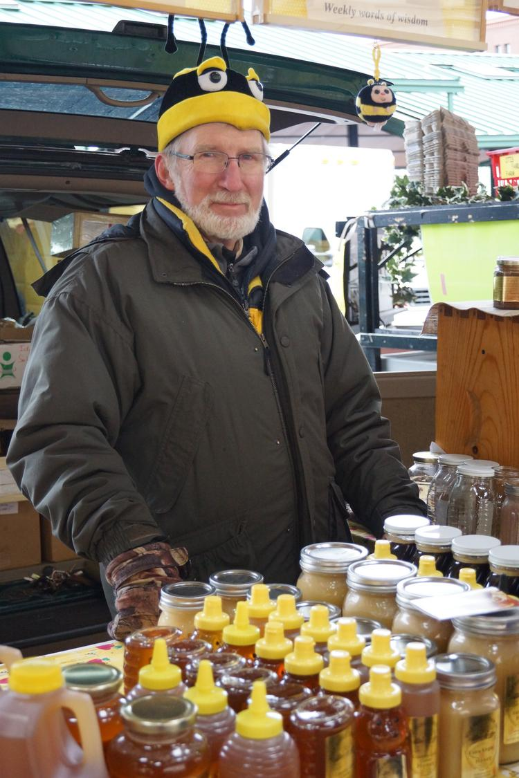 Dale Wolf of Wolf Honey Farm stayed warm Saturday in his bee hat as he sold honey and beeswax soaps at the St. Paul Farmers Market.