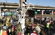 """White-painted bikes called """"ghost bikes,"""" like the one hanging from the telephone pole, are often left at the scene of severe bike-vehicle accidents."""