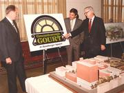 As president of 1st Home Federal Savings and Loan Association, one of Melvin's first major investments was to back the Greensborough Court at Hamburger Square redevelopment project (left). Pictured with Melvin are Bill Stevens, left, and Hugh North, both of Jefferson Life Insurance. Greensborough Court started in 1985, converting old warehouses on South Davie Street into apartments.