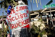 """A """"safe streets for cyclists and truckers"""" sign was among those posted on a telephone pole near the site where bike commuter Lance David was killed."""