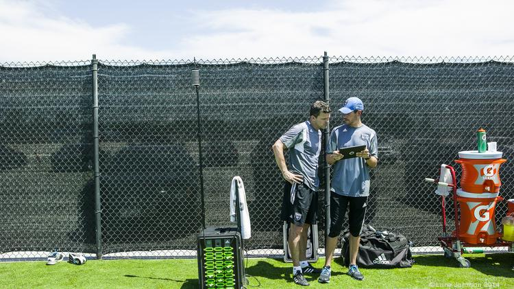 Earthquakes coach Mark Watson and assistant athletic trainer Derek Lawrance check players' heart rates on an iPad.