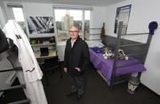 Rob Lubin, UW associate director of housing and food services, stands in a model resident (dorm) room in the newly built Alder Hall in the University District in Seattle.